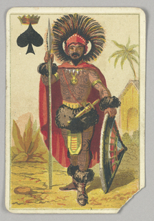 King of Spades court playing card from a pack of transformation playing cards. A colorful African chief figure shown in traditional costume, holding a spear and shield and with a large headdress. His body is covered with tattoos. Exotic landscape in background. At upper left, a spade topped with a crown.