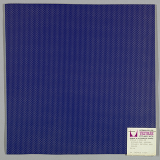 Vinyl-coated cotton knit in blue, embossed in an all-over pattern of small circles. Number 2154.