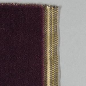 Swatch of maroon wool velvet that is unpatterned.