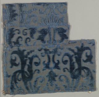 Scroll pattern on glinting metallic background. Blue.