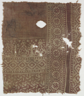 Coarse undyed cotton plain cloth forms design against red ground.  At right, broad incomplete border of rosettes with octagons, dots, and geometric forms.  At left, plain red ground at top, double band of ogive forms and wavy-edged squares.  Ground design of whirling sun motif.