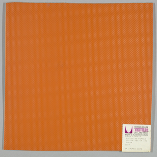Vinyl-coated cotton knit in orange, embossed in an all-over pattern of small circles. Number 2153.