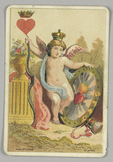 King of Hearts court playing card from a pack of transformation playing cards. Colorful figure of a cupid with pink wings, wearing a crown and holding a shield decorated with a flaming heart. A vase with flowers on a pedestal at left. At upper left corner, a red heart topped by a crown.