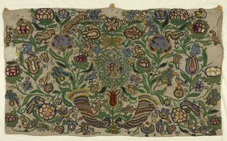 Beaded panel with three tabs on top has an elaborate design of two cornucopias, large multicolored blossoms and birds. Some flowerheads have appliqued fabric forming the petals.