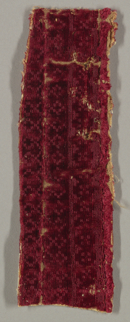Small scale pattern in cut and uncit pile in red.