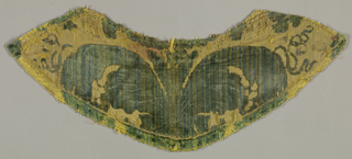 Collar of green cut and uncut velvet on yellow silk ground. Central symmetrical group of large leaves and the base of a flower.