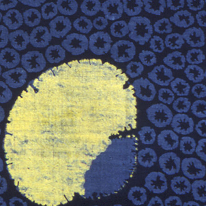 Cotton printed in imitation of tie-dye. Dark blue ground with large lemon-yellow flowerheads in full face and bees of light blue does surrounded by yellow. Border of irregular blue dots with yellow flowers in profile. Blue is warranted indigo according to attached label.