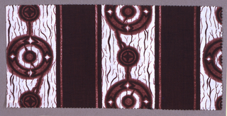 Printed cotton with broad stripes of white crackle patterned with decorated disks alternating with dark brown stripes.