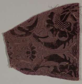 Fragment of deep wine-colored cut and uncut velvet on self-colored satin ground. Large-scale symmetrical floral motif with two large blossoms on curved stems at the bottom of the piece.