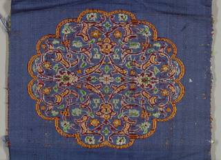 Small sample of silk, elaborate medallion design woven in red, yellow, green, and white on ground of heavy blue satin.  Left selvage present.