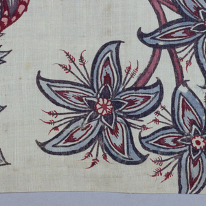 Four fragments of a large design of flowering branches on a white ground.