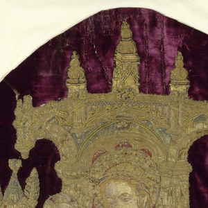 A group of embroidery fragments that have been applied to a dark red-violet velvet. Velvet is probably Spanish and dates to the 17th century. Embroideries were removed from a much earlier altar frontal. Fragments show the central tabernacle with the enthroned Virgin and child. Right and left kneeling angels hold musical instruments. Remaining angels have censers.