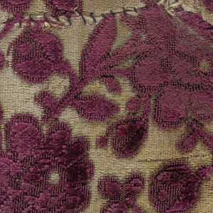 Fragment of purple cut and uncut velvet on cream-colored satin ground. Design of horizontal rows of rose branches with foliage and flowers, alternate rows facing left and right.