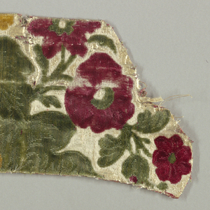 Pieces of velvet with flowers in dark red, dark yellow and dark green on white gound.