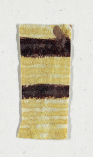 Painted and printed fragment of tapa cloth in yellow.