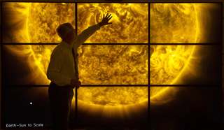 Video display of the sun's surface from the Atmospheric Imaging Assembly (AIA) aboard NASA's Solar Dynamics Observatory (SDO).  Computer hardware (CPU) to run feed of activity on the sun's surface.