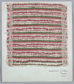 Woven sample mounted to a cardboard card with notations by the designer. Horizontal stripes of green, red, pink and clear plastic. Warp is clear plastic strips alternating with plied beige yarn. Weft is of red bouclé, paired beige twisted and untwisted yarn, pink chenille, red untwisted yarn, and two different green plied yarns.