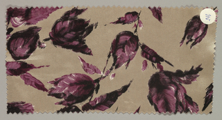 Light brown ground has an allover floral pattern with short stems and leaves in dark and light maroon.