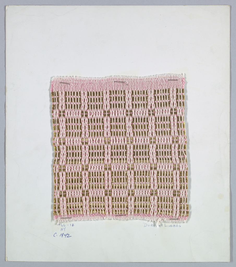 Woven sample mounted to a cardboard card with notations by the designer. Checkerboard pattern in pink and metallic gold. Warp is pale pink cotton. Foundation weft is darker pink bouclé; supplementary weft is paired wrapped gold metallic yarns.