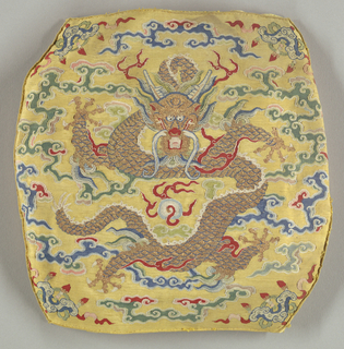 Four pieces which, when assembled, would form a small pillow.  Each panel contains a dragon with fangs surrounde by cloud motifs.