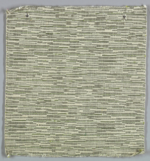 Sample of hand woven cotton in which the warps are much thinner and more tightly twisted than the loosely-twisted, slubby wefts. The wefts are grouped in combinations which vary across the width of the fabric, giving a meandering, rather than strictly grid-like, appearance. Olive and ivory warps; ivory and green wefts.