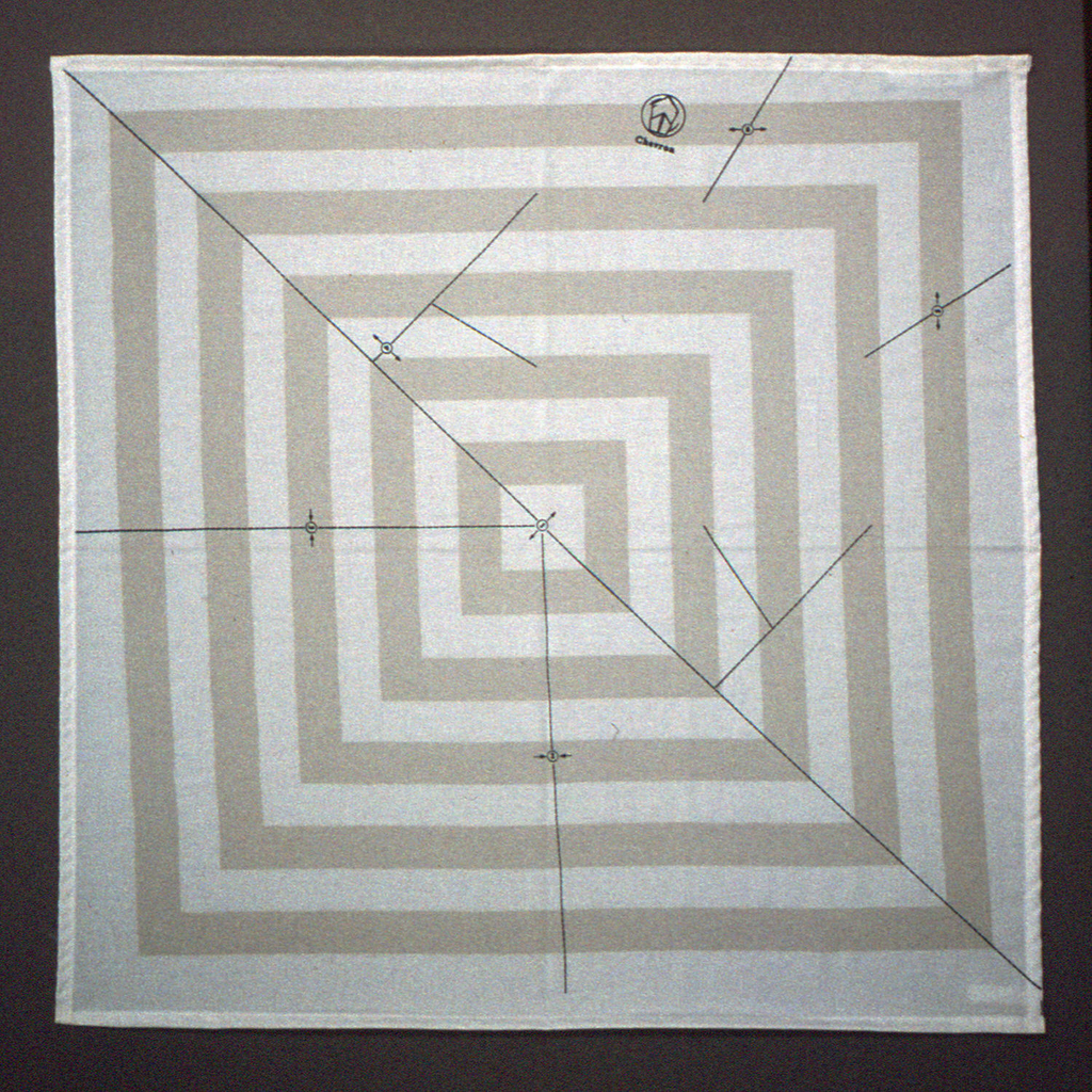 Instructions for folding a napkin into a chevron shape printed in navy on a background of concentric squares of beige on white.