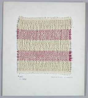 Woven sample mounted to a cardboard card with notations by the designer. Horizontal stripes of white and bright pink. Warp alternates smooth and bouclé yarns. Weft has bands of wrapped pink metallic yarn paired with transparent pink plastic strip, and silver metallic yarn paired with clear plastic strip.