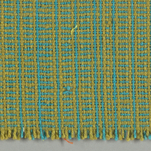 Woven sample with a delicate, hatched appearance through alternation of a chartreuse and turquoise warp and weft.