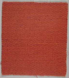 Hand-woven sample of a textile in red and orange chenille and red metal.