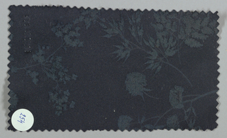 Black ground has an allover pattern of flowers, leaves, sprigs, and sprays in a dark gray tone.