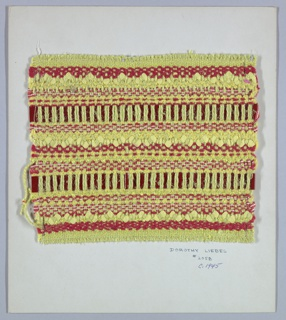Woven sample mounted to a cardboard card with notations by the designer. Horizontal stripes of varied textures in browns and yellows. Warp is yellow two-ply yarn. Weft has a variety of yarns including: red two-ply yarn, yellow rickrack woven braid, crinkled paper ribbon, yellow chenille, yellow bouclé, and red imitation leather. The rickrack and some of the chenille passes over three and under one warp.