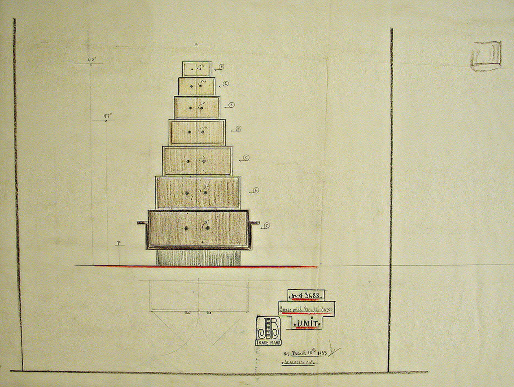 Design for unit consisting of 7 double door horizontal boxes on base, ascending in size from top.*  Sketch under drawing shows elevation of the swing of doors.  * Doors are numbered at right of each box: 1-7.