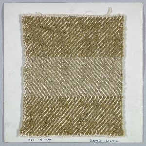 Woven sample mounted to a cardboard card with notations by the designer. Three broad horizontal stripes in shades of green, with a vertical herringbone design which changes direction at the point of color change. Warp is off-white cotton; wefts are green cotton chenille. Selvage at left side.