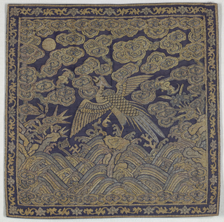 Qing dynasty Mandarin rank badge with crane, waves, plant forms, and clouds. Mainly in dark blue and gold.