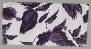 White ground has an allover floral pattern with short stems and leaves in dark and light purple.