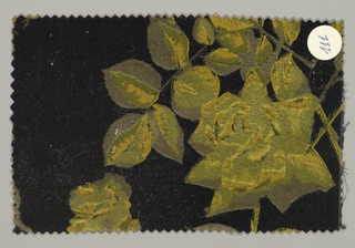 Black ground has an allover pattern of yellow-green roses with yellow-green leaves and stems; taupe color used for shading.