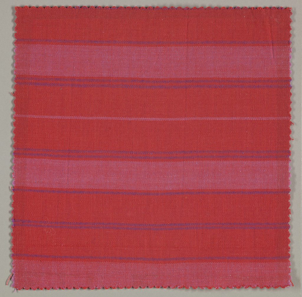 Sample of a hand woven cotton with irregular wide and narrow weft stripes of red, dark purple and light purple. The warp is red throughout.