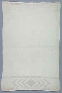 Fine undyed silk towel, closely woven, with simple broad decorated band in leno across one end, narrow band at other end. Plain selvedges on long sides, hand-hemmed on short sides.