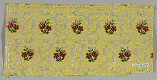 Yellow horizontally ribbed ground. Ground divided into roughly oval areas by lacy bands in extra white silk weft. In center of each oval a small spray of flowers in extra wefts of red, pink, green and blue silk.  Flat gold strips originally over yellow ground.