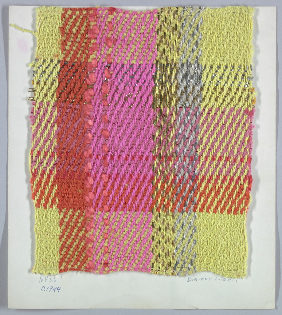 2/2 twill plaid with paired and unpaired warps and paired and unpaired wefts. Warp has stripes of yellow boucle that alternates with yellow three-ply yarn; a stripe of orange two-ply yarn, orange smooth yarn; a stripe of pink two-ply yarn; stripe of metallic gold yarn of grouped warp of flat metallic; double wrapped metallic; single wrapped metallic and yellow ply yarn; same stripe in silver and gray yarn. Weft has bands of yellow, orange, pink chenille paired with red flat metallic, orange smooth year, and paired flat and wrapped metallic gold and silver.