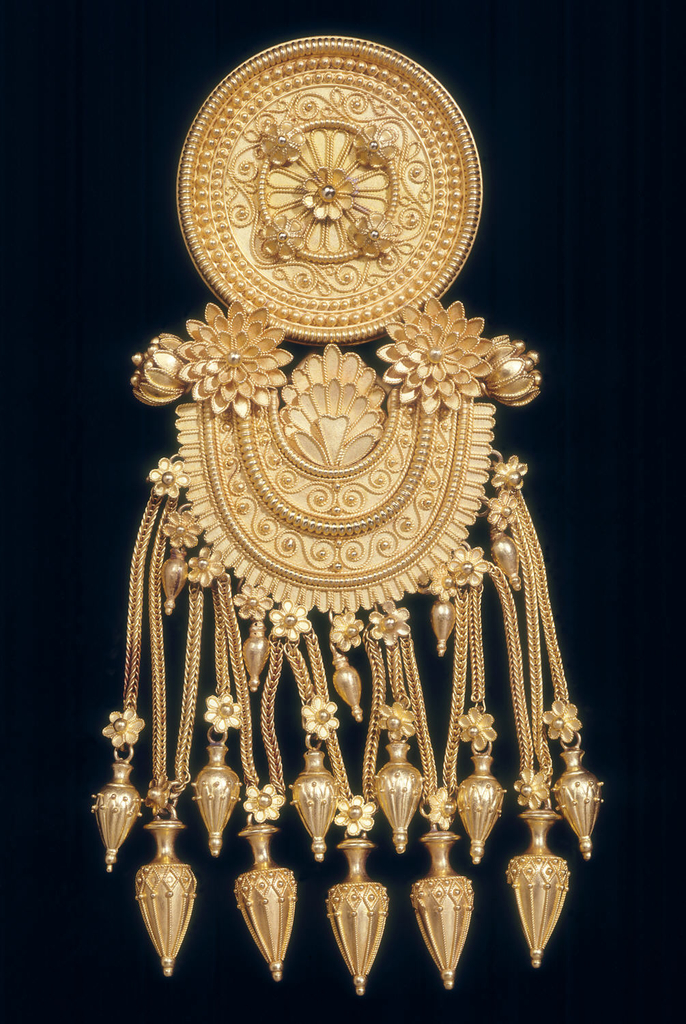 Large gold pendant broach with circular top, arched section below from which hang 11 vase-shaped pendants.  Fine gold granulation work throughout.  The design of this brooch, like some other pieces made by the Castellanis, is based closely on jewelry unearthed at an important archeological site at Kol Oba in Southern Russia, discovered in 1830.  Drawings of the jewels, which date from the 4th century BCE, were published after their transferral to the Hermitage in St. Petersburg.