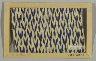 White cotton, very soft and fine, with warp ikat pattern on small scale in blue; Y-shaped forms going across fabric. No selvages present.