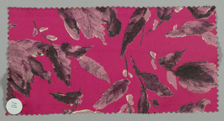 Dark pink ground has an allover floral pattern with short stems and leaves in shades of mauve.