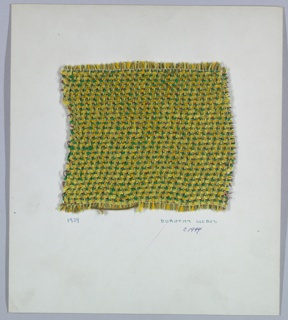 Woven sample mounted to a cardboard card with notations by the designer. Twill weave in yellows and greens with metallic red accents. Warp has a repeating sequence of light green bouclé, two-ply green yarn, and yellow yarn. Weft has a repeating sequence of yellow chenille, green bouclé, and flat red metallic strip paired with three strands wrapped red metallic cord. Selvedge at left.