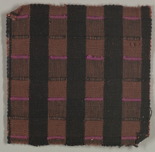 Sample of hand-woven cotton in which the warps are thinner and more tightly twisted than the loosely-twisted, slubby wefts. Wide stripes in each direction are interrupted occasionally with very narrow ones of 2 warps or wefts each. The vertical stripes are accented with insertions of discontinuous weft which is very thick and raised. Brown and black warps; brown wefts; purple and black brocading yarns.