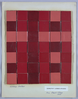Plaid made by the interlacings of different tones of red leather. Each strip is 1.5 inches wide.