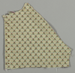 Small-scale design forming a diamond grid in cream, blue, pink, cerise, maroon and green. Piece is a fragment of a garment.
