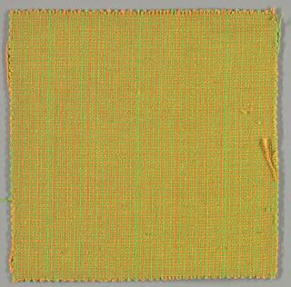 Woven sample with a delicate, hatched appearance through alternation of a green and orange warp and a green and yellow weft.