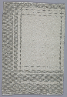 Cream silk table mat with borders of broad and narrow bands of silver. Hand-hemmed on short edges. Woven in so-called summer and winter weave.