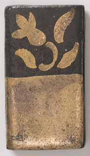 Oblong, one half covered with gold over black, the other with gold flower on black field.